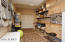Built In Cabinets & Shelves. Water Heater & Water Softener behind doors.