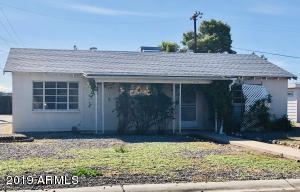 Charming home in Youngtown on corner lot.