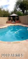 Arizona weather calls for a refreshing pool. This one has a new pump! Depth of 6' at the center.