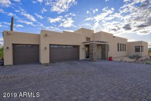 This contemporary Santa Fe style home boasts oversized attached three car garage has plenty of room for all your toys and vehicles. Beautiful paver driveway has plenty of parking space for guests as well.