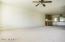 Living room, neutral carpet, ceiling fan w/light.