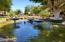 Large walkways and lush grounds surround this gorgeous tranquil pond area.