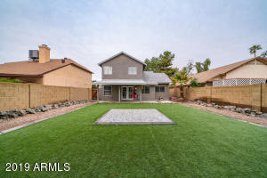 The extended covered patio overlooks artificial turf and mature landscaping, perfect for your 4 legged family member.
