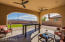 Large covered patio looks out to Estrella Mountains.