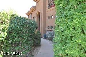 Guard Gated; Elevator in Unit! Views! Lush landscaping...