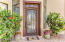 Beautiful custom Iron door opens to the front entry.