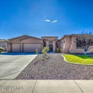 STUNNING single level home with attached GUEST QUARTERS that comes with its own private entrance.  This beauty is on a large lot, nestled in a fantastic community of only 25 semi-custom homes, located less than a mile from the 19th Ave. Trail Head of S. Mountain, offering miles of hiking and biking trails!  The interior boasts fresh paint, a gas fireplace and slat stone throughout with carpet and walk-in closets in ALL of the rooms, & the master bedroom also offers an additional office/sitting room.  SELLER TO INSTALL NEW STAINLESS-STEEL RANGE, MICROWAVE & DISHWASHER in the kitchen before closing in addition to the recently installed granite counter-tops.  ACT NOW, this beauty won't last... Homes in this community rarely come on the market!