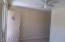 Front Door into Living Room FANS IN EVERY ROOM