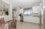 Kitchen with Stainless Appliances, Granite Countertops, Pantry and Built-In Bench Seating