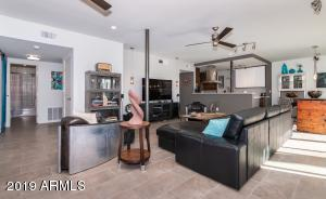 Expansive living room with views to the open kitchen.