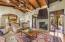 Family room opens to the kitchen and outdoor patios for easy indoor/outdoor entertaining.