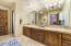 Jack-and-Jill bathroom offers dual sinks, tub/shower combination, private toilet room and is spacious in size for sharing.