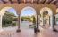 Enjoy this Spanish Mediterranean style home with arches throughout.
