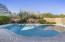 Resort like pool and spa with custom mosaic architectural feature.