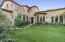The spacious side yard is perfect for outdoor fun and games.