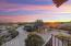 Enjoy beautiful sunsets from the front yard and upper balcony.