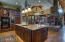 Custom cabinetry and lovely granite w/ 3 way fireplace