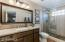 All New Cabinets, Granite, Gorgeous Shower, Beautiful Mirror and Fixtures.