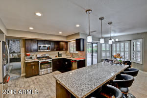 Gorgeous cabinets, stainless appliances, granite counters with huge breakfast bar is perfect for today's lifestyle.
