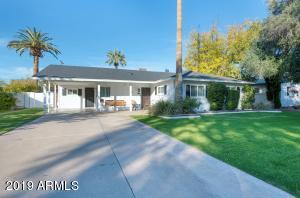 This updated ranch home is located in one of the most desirable areas in Arcadia Lite! This prime location is just moments away from fabulous restaurants and bars, such as Beckett's Table, La Grande Orange, Postino, The Vig, and much more! Featuring a split floor plan with 3 bedrooms and 3 bathrooms, this open concept layout offers two living areas, formal dining, and upgraded kitchen with breakfast bar. The master retreat provides direct access to the entertainer's backyard, complete with newer rooftop viewing deck, outdoor kitchen, gas fire pit, and a sparkling pool with a gazebo/cabana. The indoor laundry room was also recently revamped to provide additional storage space.