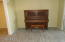 ANTIQUE PIANO IN DINING ROOM