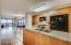 Granite slab, custom cabinetry, gas cooktop