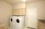 Generous Laundry Room with Built-In Cabinets and Sink