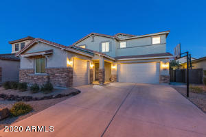 The Grand curb appeal of this home welcomes you home each day
