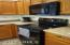 Kitchen has new microwave and glass top range/stove