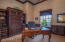 Custom tea stained wall treatments and Stone Creek built ins enhance this den