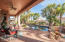11 palm trees surround this magnificent backyard