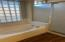Master features large soaking tub & spacious shower.