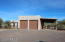 Two pull-thru RV bays, 60' long with 12'x12' garage doors at both ends., plus additional covered parking adjacent.