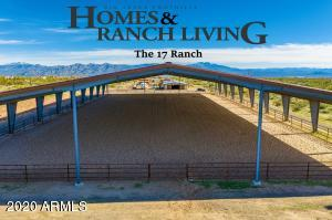 Covered arena, 6+ acres, luxury guest casita's, heated pool/spa, show barn, 17 stalls, turn outs, RV hook ups, fenced, gated, and more