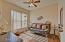 Homeowner enclosed this space. May be used as guest bedroom, den, office. Wood-look tile flooring