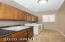 Spacious laundry room with sink and lots of cabinets