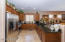Nicely upgraded kitchen with granite counters & stainless appliances