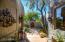 Newly Created Inner Courtyard with Custom Wood Door