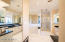 Large Master Suite Bathroom with Sunken Tub, Separate Shower, vanities and WC