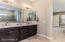 Master bath with dual sinks and designer touches