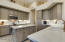 Kitchen with high end Quartz counters, Satin Brass hardware and stainless appliances