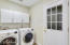 Inside laundry with the washer and dryer