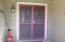 Double door entry with custom security doors