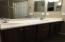 Dual sink vanity with cabinets.