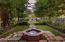Gorgeous formal garden is like you'd see in the movies. Look at the fireplace and seating area in the background.