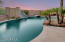 Pool and spa with custom built in slide.
