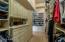 Huge master closet with incredible cabinets/shelving/shoe racks.