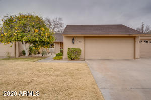 Enjoy the mature grapefruit tree in the front yard...large courtyard...3 Bedroom/1.75 Bathrooms