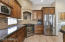 Gourmet kitchen with Custom Hood, Frigidaire, LG and Bosch Stainless Appliances and Granite Countertops and Kitchen Island.