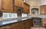 Gourmet Kitchen with Custom Hood, Stainless Appliances and Granite Countertops